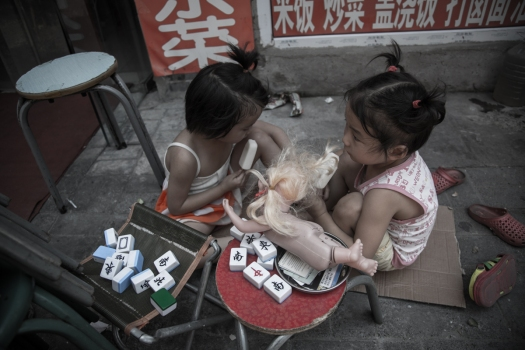 Two Chinese girls playing in a Hutong Neighbourhood in Beijing